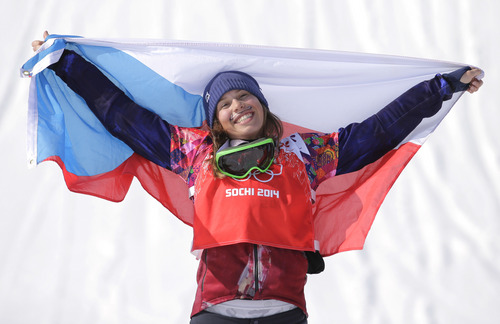 Czech Republic's Eva Samkova celebrates after taking the gold medal in the women's snowboard cross final at the Rosa Khutor Extreme Park, at the 2014 Winter Olympics, Sunday, Feb. 16, 2014, in Krasnaya Polyana, Russia. (AP Photo/Andy Wong)
