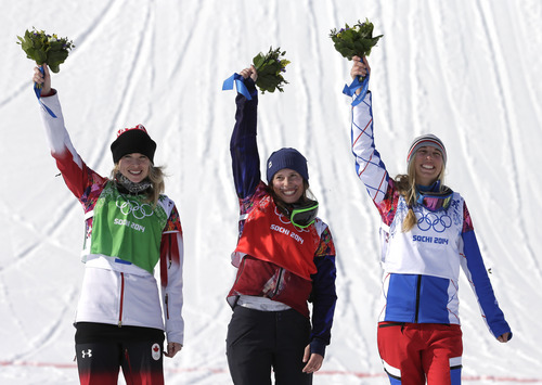 Czech Republic's Eva Samkova, center, celebrates after taking the gold medal in the women's snowboard cross final, ahead of silver medalist Dominique Maltais of Canada, left, and bronze medalist France's Chloe Trespeuch at the Rosa Khutor Extreme Park, at the 2014 Winter Olympics, Sunday, Feb. 16, 2014, in Krasnaya Polyana, Russia. (AP Photo/Andy Wong)