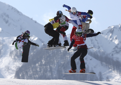 Czech Republic's Eva Samkova, front right, leads the field in the women's snowboard cross final at the Rosa Khutor Extreme Park, at the 2014 Winter Olympics, Sunday, Feb. 16, 2014, in Krasnaya Polyana, Russia. Samkova went on to win the gold medal. (AP Photo/Luca Bruno)