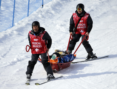 Jacqueline Hernandez of the United States is carried in a stretcher after crashing in a seeding run during women's snowboard cross competition at the Rosa Khutor Extreme Park, at the 2014 Winter Olympics, Sunday, Feb. 16, 2014, in Krasnaya Polyana, Russia. (AP Photo/Andy Wong)