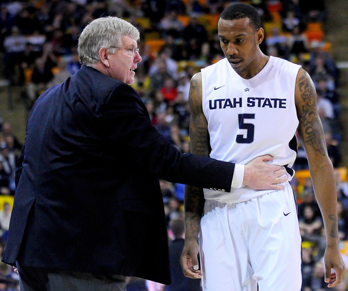 Utah State coach Stew Morrill, left, talks with Jarred Shaw who walks off the court during an NCAA college basketball game against UNLV, Saturday, Feb. 15, 2014, in Logan, Utah. (AP Photo/Herald Journal, John Zsiray)