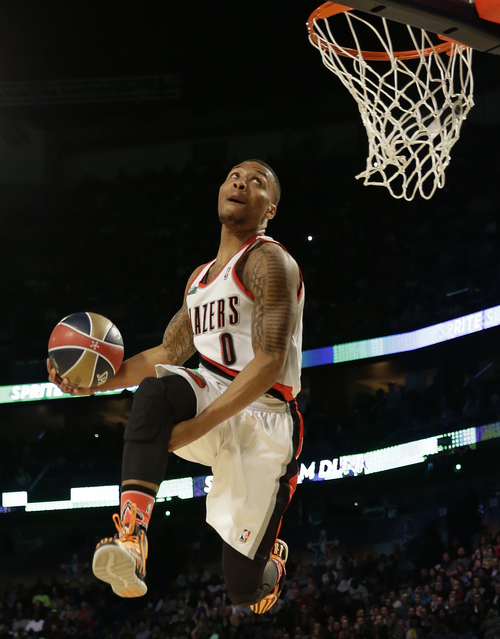 Damian Lillard of the Portland Train Blazers participates in the slam dunk contest during the skills competition at the NBA All Star basketball game, Saturday, Feb. 15, 2014, in New Orleans. (AP Photo/Gerald Herbert)