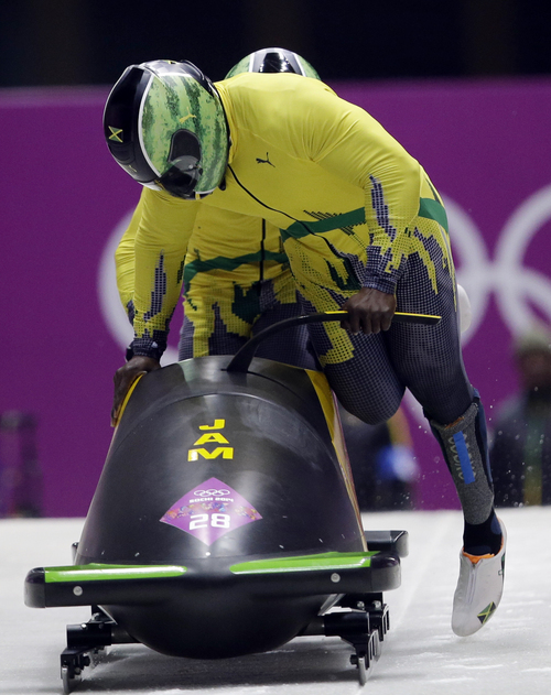 Dita Alangkara | The Associated Press The two-man bobsled team from Jamaica, piloted by Evanston, Wyo., resident Winston Watts, front, and including brakeman Marvin Dixon, start their first run during competition Sunday.