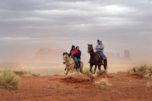 Rick Egan  | The Salt Lake Tribune   Jaydon Yazzie, VanteJren Atene, and  McKalette Clark ride home from Monument Valley High School on their horses, Thursday, January 30, 2014.