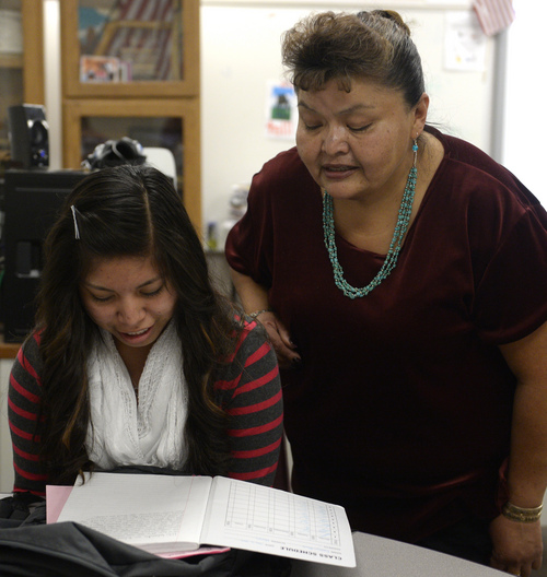 Rick Egan  |  The Salt Lake Tribune Caitlyn Black, left, reads a story she wrote in the Navajo language to her teacher, Dorothy Bigman, during class time at Monument Valley High School in January.