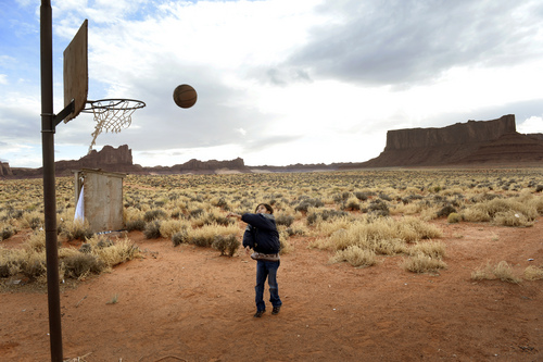 Rick Egan  | The Salt Lake Tribune   Karlicia Smith, 9, shoots a few baskets on the hoop at her family's home in Monument Valley on Friday, January 31, 2014.