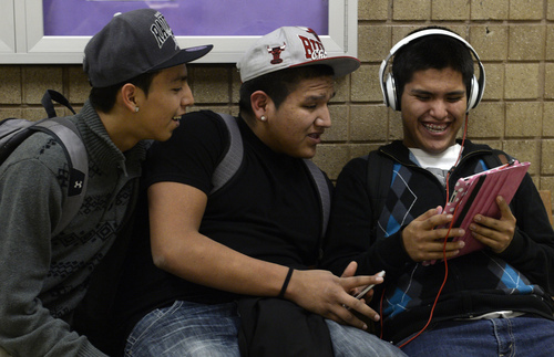 Rick Egan  |  The Salt Lake Tribune Sergio Morales, Kurtis Holiday and Kevin Bedonie watch YouTube videos on an iPad after school at  Monument Valley High School in January.