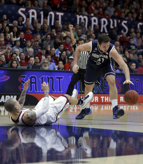 BYU's Luke Worthington, right, reaches for the ball after colliding with Saint Mary's Kerry Carter in the first half of an NCAA college basketball game on Saturday, Feb. 15, 2014, in Moraga, Calif. (AP Photo/Ben Margot)