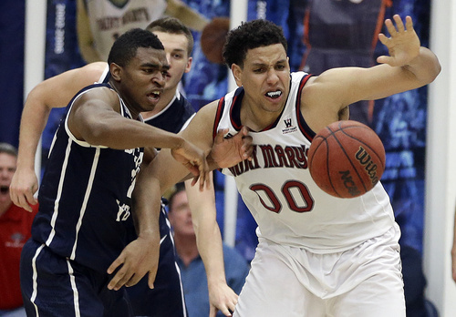 BYU's Anson Winder, left, and Saint Mary's Brad Waldow (00) chase a loose ball in the second half of an NCAA college basketball game on Saturday, Feb. 15, 2014, in Moraga, Calif. (AP Photo/Ben Margot)