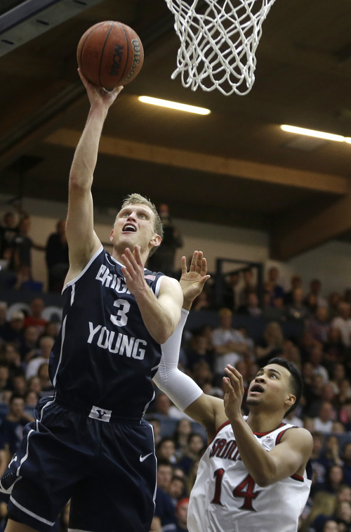 BYU's Tyler Haws (3) shoots over Saint Mary's Stephen Holt in the second half of an NCAA college basketball game on Saturday, Feb. 15, 2014, in Moraga, Calif. (AP Photo/Ben Margot)