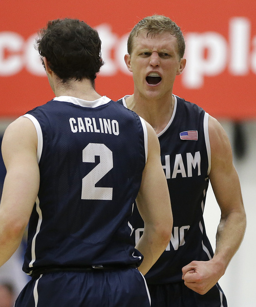 BYU's Tyler Haws, right, celebrates beside teammate  Matt Carlino (2) after scoring against Saint Mary's in the second half of an NCAA college basketball game on Saturday, Feb. 15, 2014, in Moraga, Calif. (AP Photo/Ben Margot)