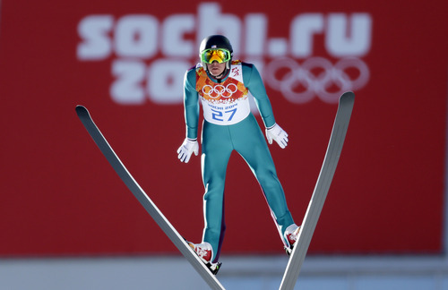 United States' Bill Demong makes his trial jump during the ski jumping portion of the Nordic combined at the 2014 Winter Olympics, Wednesday, Feb. 12, 2014, in Krasnaya Polyana, Russia. (AP Photo/Matthias Schrader)
