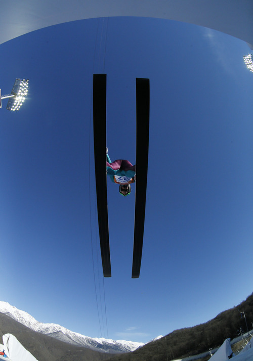 In this photo taken with a fisheye lens United States' Bill Demong makes his trial jump during the ski jumping portion of the Nordic combined at the 2014 Winter Olympics, Wednesday, Feb. 12, 2014, in Krasnaya Polyana, Russia. (AP Photo/Dmitry Lovetsky)