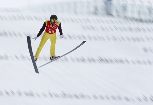 Bill Demong of the United States makes his jump during a men's Nordic combined, large hill, training session at the 2014 Winter Olympics, Monday, Feb. 17, 2014, in Krasnaya Polyana, Russia. (AP Photo/Dmitry Lovetsky)