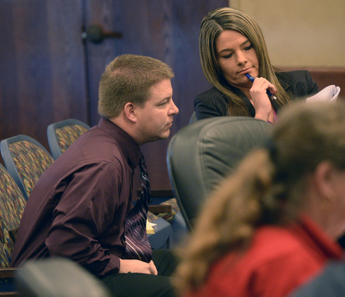 Al Hartmann  |  The Salt Lake Tribune  Shaun Cowley, left, talks to his defense lawyer Lindsay Jarivis in a pre-hearing conference before the West Valley City Civil Service Commission Tuesday February 18, 2014. Cowley is fighting to get back on the West Valley City Police force.