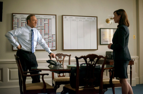 """This image released by Netflix shows Kevin Spacey, left, and Molly Parker in a scene from """"House of Cards."""" The second season of the popular original series premieres on Friday, Feb. 14, 2014 on Netflix. (AP Photo/Netflix, Nathaniel E. Bell)"""