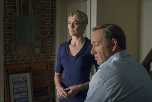 """This image released by Netflix shows Robin Wright as Clair Underwood, left, and Kevin Spacey as Francis Underwood in a scene from """"House of Cards."""" The second season of the popular original series premieres on Friday, Feb. 14, 2014 on Netflix. (AP Photo/Netflix, Nathaniel E. Bell)"""
