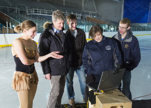 | Courtesy Brigham Young University  From left,  skater Jacquelyn Packard, BYU engineering professor Tadd Truscott, BYU student Danny Smith, exercise science professor Sarah Ridge and student  Jeremy Ellis view high-speed footage of a jump's impact on Packard.