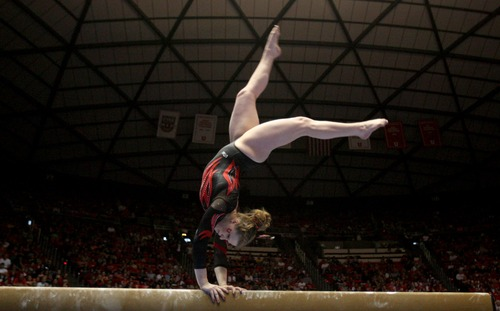 Kim Raff  |  The Salt Lake Tribune Utah gymnast Tory Wilson performs her routine on the beam during a meet against Florida at the Huntsman Center in Salt Lake City on March 16, 2013. Utah went on to beat Florida in the meet.