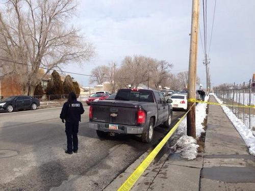 Jim Dalrymple II  |   The Salt Lake Tribune  Police close off a street in Magna after a man reportedly shot at police after trying to cash or deposit a forged or bad check on Thursday Feb. 6, 2014.
