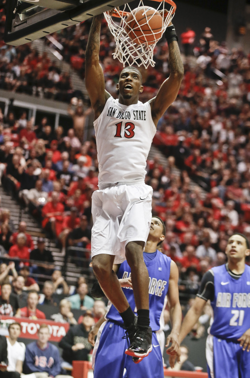 San Diego State forward Winston Shepard dunks against Air Force during the second half of San Diego State's 64-56 victory in an NCAA college basketball game Saturday, Feb. 15, 2014, in San Diego. (AP Photo/Lenny Ignelzi)