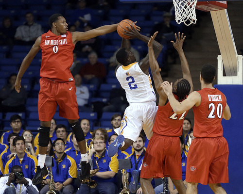 San Diego State's Skylar Spencer (0) blocks the shot of San Jose State's Jaleel Williams (2) during the first half of an NCAA college basketball game Wednesday, Jan. 22, 2014, in San Jose, Calif. (AP Photo/Ben Margot)