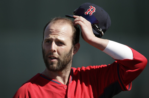 Boston Red Sox second baseman Dustin Pedroia removes his hat during spring training baseball practice, Monday, Feb. 17, 2014, in Fort Myers, Fla. (AP Photo/Steven Senne)