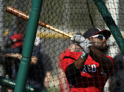 Boston Red Sox center fielder Jackie Bradley Jr. follows through on a swing at batting practice during spring training baseball practice, Monday, Feb. 17, 2014, in Fort Myers, Fla. (AP Photo/Steven Senne)