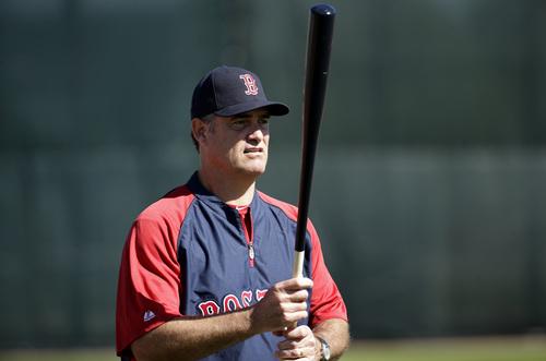 Boston Red Sox manager John Farrell holds a bat during spring training baseball practice, Monday, Feb. 17, 2014, in Fort Myers, Fla. (AP Photo/Steven Senne)