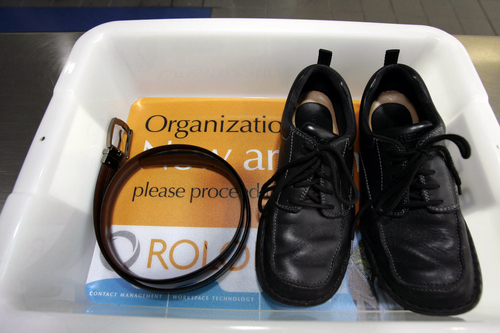 FILE - In this Wednesday, Jan. 10, 2007, file photo, a belt and shoes sit in a trays with advertising that is being used in the safety screening of travelers done by the Transportation Security Administration, at the Los Angeles International Airport in Los Angeles. The U.S Department of Homeland Security said Wednesday, Feb. 19, 2014, it is warning airlines that terrorists could try to hide explosives in shoes. It's the second time in less than three weeks that the government has issued a warning about possible attempts to smuggle explosives on a commercial jetliner. (AP Photo/Ann Johansson, File)