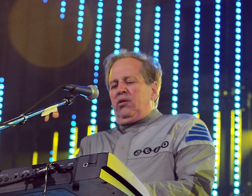 "FILE - This June 5, 2010 file photo shows Bob Casale performing live at The 2010 KROQ Weenie Roast in Irvine, Calif. Casale, of the band Devo best known for the 1980s hit ""Whip It,"" died Monday, Feb. 17, 2014, from conditions that led to heart failure, his brother and band member Gerald Casale said Tuesday. He was 61. Devo founder Gerald says in a statement his younger brother's death was ""sudden"" and ""a total shock."" (AP Photo/Katy Winn, File)"