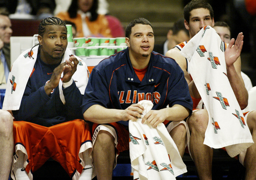 Illinois starters from left,  Dee Brown, Deron Williams and James Augustine applaud late in the game during the team's 68-51 win over Northwestern in a quarterfinal game at the Big Ten tournament Friday, March 11, 2005, at the United Center in Chicago. (AP Photo/Michael Conroy)