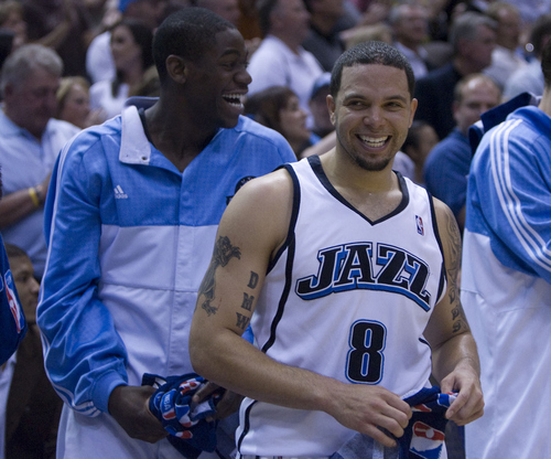 Ronnie Brewer, left, and Deron Williams are all smiles as the Jazz pull ahead late in their win over the Rockets in Game 6.    Rick Egan/TheSalt Lake Tribune   5/2/08