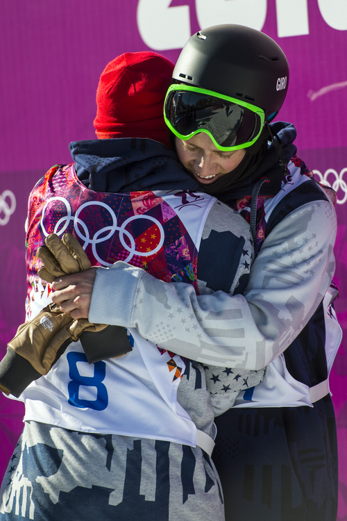 KRASNAYA POLYANA, RUSSIA  - JANUARY 13: Joss Christiensen hugs Gus Kenworthy after winning the men's ski slopestyle competition at Rosa Khutor Extreme Park during the 2014 Sochi Olympics Thursday February 13, 2014. Joss Christiensen, of Park City, Utah, won the gold medal with a score of  95.80. Gus Kenworthy, of Telluride, Colo., won the silver with a 93.60. Nick Goepper, of Lawrenceburg, Ind., won the bronze with a 92.40. It marked only the third time that the United States has swept the medals in an Olympic Winter Games event. (Photo by Chris Detrick/The Salt Lake Tribune)