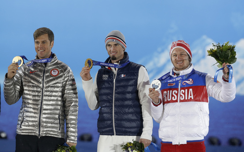 Men's snowboard cross medalists, from left, the United States' Alex Deibold, bronze, France's Pierre Vaultier, gold, and Russia's Nikolai Olyunin, silver, pose with their medals at the 2014 Winter Olympics in Sochi, Russia, Tuesday, Feb. 18, 2014. (AP Photo/Morry Gash)