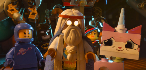 "This image released by Warner Bros. Pictures shows characters, from left, Benny, voiced by Charlie Day, Batman, voiced by Will Arnett, Vitruvius, voiced by Morgan Freeman, Wyldstyle, voiced by Elizabeth Banks and Unikitty, voiced by Alison Brie, in a scene from ""The Lego Movie."" (AP Photo/Warner Bros. Pictures)"