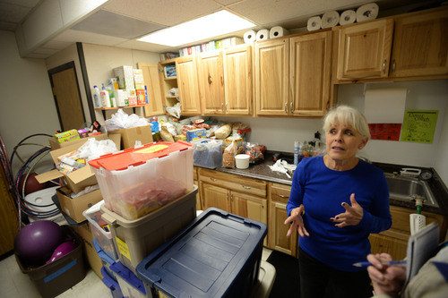 Steve Griffin  |  The Salt Lake Tribune  Linda Martinez Saville in the Sandy Club's kitchen area, Friday, February 14, 2014.  Space at the club is so tight that  some games and toys are stored in the kitchen. The nonprofit club bought nearby land last year to construct a bigger center.