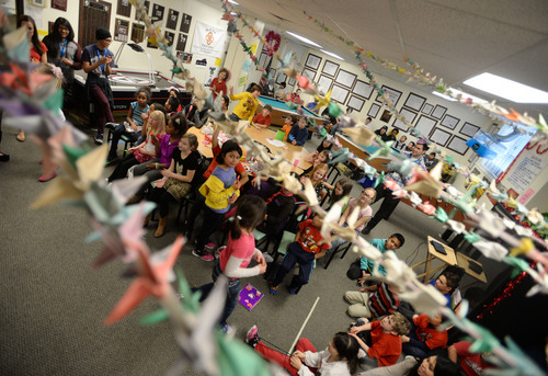 Steve Griffin  |  The Salt Lake Tribune  Paper cranes stretch across the ceiling at the Sandy Club, where children perform in a talent show. Sandy, Utah, Friday, February 14, 2014.