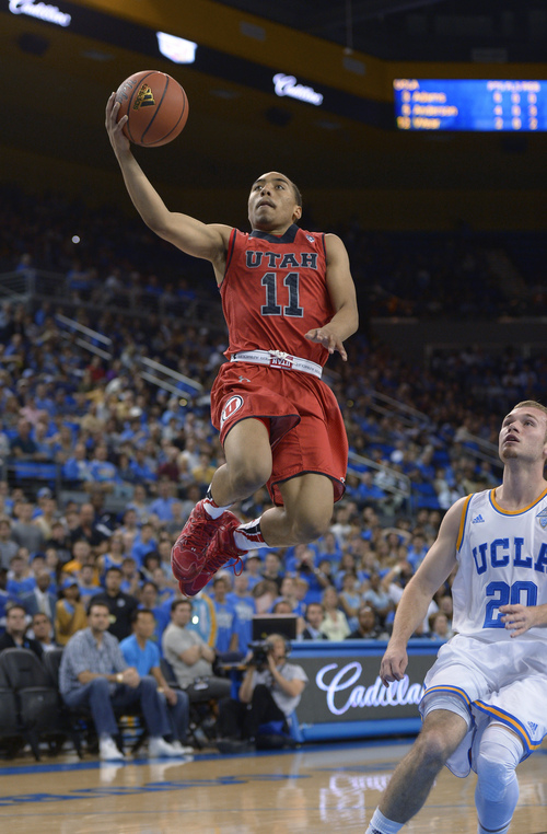 Utah guard Brandon Taylor, left, puts up a shot as UCLA guard Bryce Alford watches during the first half of an NCAA college basketball game, Saturday, Feb. 15, 2014, in Los Angeles. (AP Photo/Mark J. Terrill)