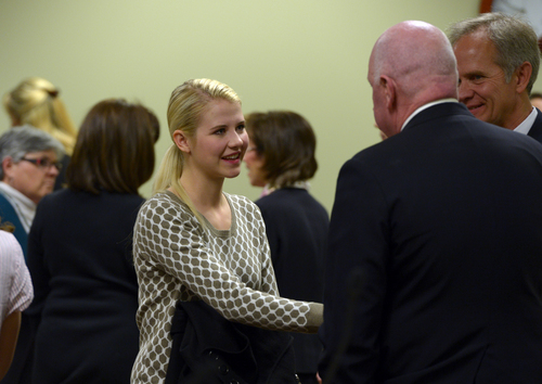 Scott Sommerdorf   |  The Salt Lake Tribune Elizabeth Smart greets Sen. Howard Stephenson, R-Draper, after debate on HB286 in committee, Wednesday, Feb. 19, 2014. Her father, Ed Smart, is at right.