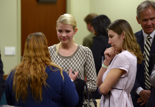 Scott Sommerdorf   |  The Salt Lake Tribune Elizabeth Smart speaks with others who attended the committee meeting where HB286 - Child Sexual Abuse Prevention - was heard in committee, Wednesday, Feb. 19, 2014. Her father, Ed Smart, is at right.