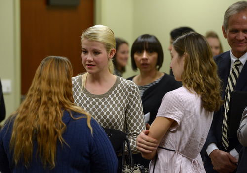 Scott Sommerdorf   |  The Salt Lake Tribune Elizabeth Smart speaks with others who attended the committee meeting where HB286 - Child Sexual Abuse Prevention - was heard in committee, Wednesday, Feb. 19, 2014. Her father, Ed Smart, is at right. The sponsor of the bill, Rep. Angela Romero, D-Salt Lake City, is just to the right of Elizabeth Smart.