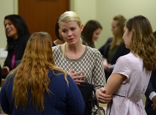 Scott Sommerdorf   |  The Salt Lake Tribune Elizabeth Smart speaks with others who attended the committee meeting where HB286 - Child Sexual Abuse Prevention - was heard in committee, Wednesday, Feb. 19, 2014.
