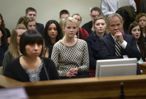 Scott Sommerdorf   |  The Salt Lake Tribune Elizabeth Smart, center, along with her father Ed Smart, right, listen to debate on HB286 in committee, Wednesday, Feb. 19, 2014. The sponsor of the bill, Rep. Angela Romero, D-Salt Lake City, is at left.