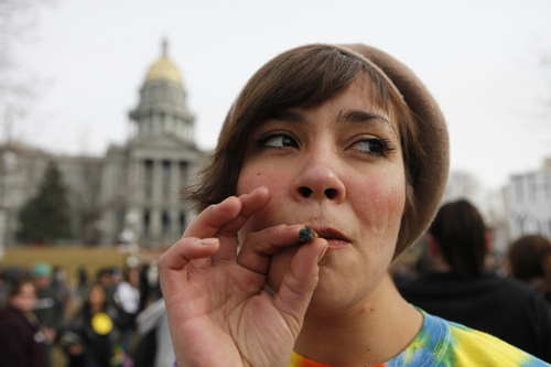 Ed Andrieski  |  The Associated Press Jenny smokes a marijuana cigarette in January at a medical marijuana rally at Lincoln Park across from the Capitol in Denver, Colo.