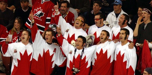 |  Tribune file photo Fans of the Canadian men's hockey team cheer as Canada beats Belarus 7-1 to advance to the gold medal game during the 2002 Salt Lake Games.