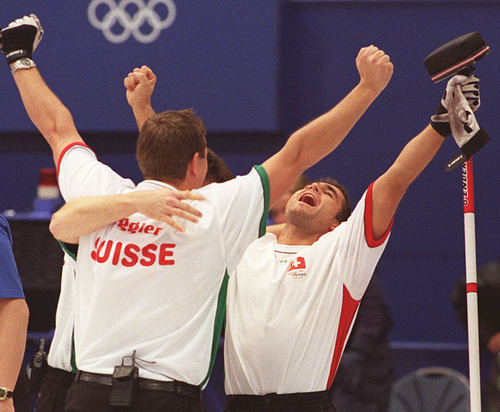 |  Tribune file photo Markus Eggler,left, and Damian Grichting of team Switzerland celebrate after defeating team Sweden 7-3 to winning the bronze medal in curling during the 2002 Salt Lake Games.
