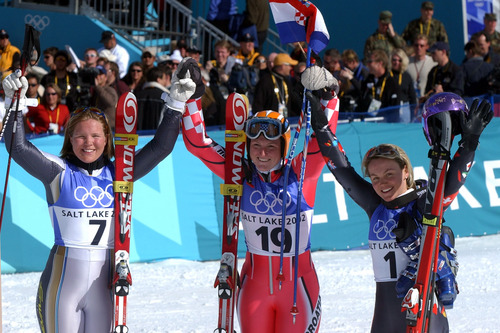 Rick Egan  |  Tribune file photo Silver medalist Anja Pearson, gold medalist Janica Kostelic, and bronze medalist Sonja Nef , celebrate after competing in the women's giant slalom during the 2002 Salt Lake Games.