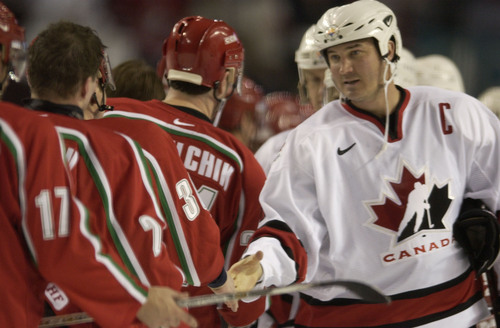 |  Tribune file photo Mario Lemieux extends a handshake to the members of team Belarus after Canada won 7-1 during their game at the 2002 Salt Lake Games.