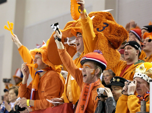 Steve Griffin  |  Tribune file photo Dutch fans celebrate their country's gold and silver medals in the men's 10,000 meters at the Utah Olympic Oval during the 2002 Salt Lake Games.